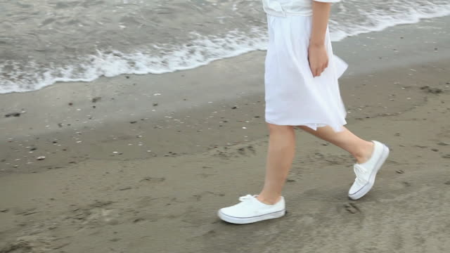 ms woman walking on beach and finding shell / ksai, tokyo, japan  - animal shell stock videos & royalty-free footage