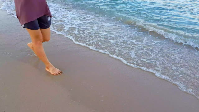 woman walking on beach - grace bay stock videos and b-roll footage