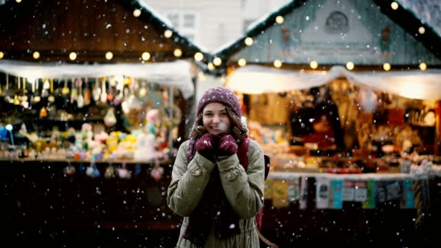 woman walking on christmas market - neve video stock e b–roll