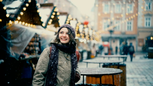 woman walking on christmas market - austria stock videos and b-roll footage