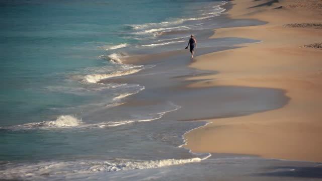 ws woman walking on darkwood beach / darkwood beach, antigua and barbuda - only mature women stock videos & royalty-free footage