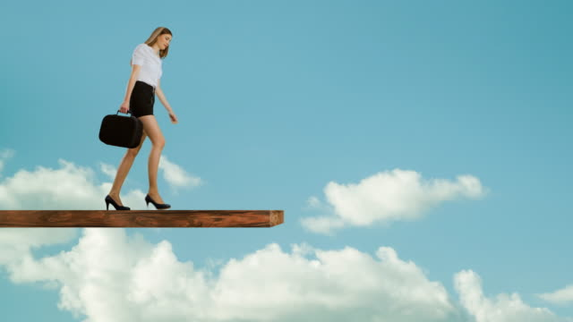 woman walking on edge of plank - matte board stock videos & royalty-free footage