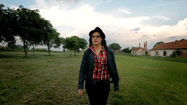 woman walking on field,camera stabilization shoot - girl power stock videos & royalty-free footage