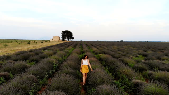 Woman walking on  lavender field in Provence