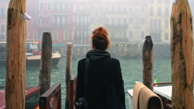 woman walking on pier - venice italy stock videos & royalty-free footage
