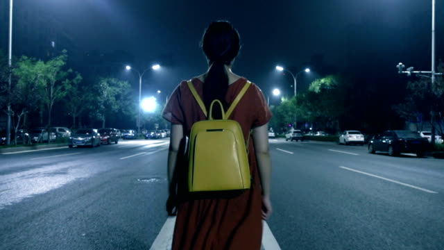 woman walking on street at night lonely - ominous stock videos & royalty-free footage
