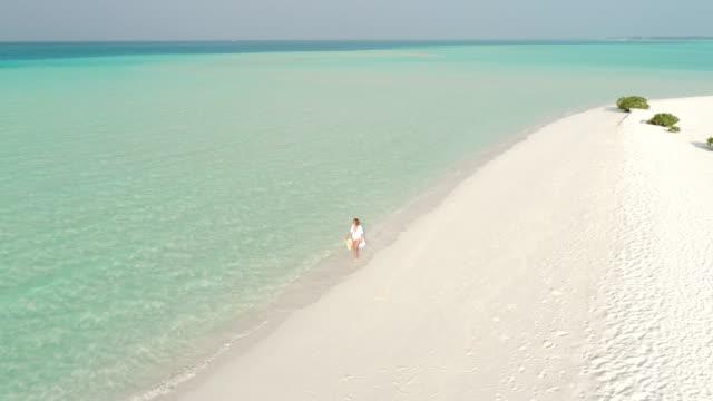 ws woman walking on sunny tropical beach,maldives - maldives stock videos & royalty-free footage
