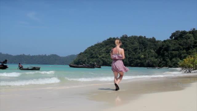 woman walking on the beach - andaman sea stock videos & royalty-free footage