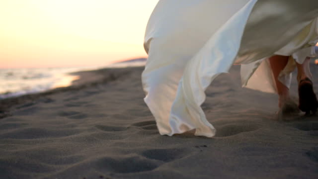 woman walking on the beach - dress stock videos & royalty-free footage