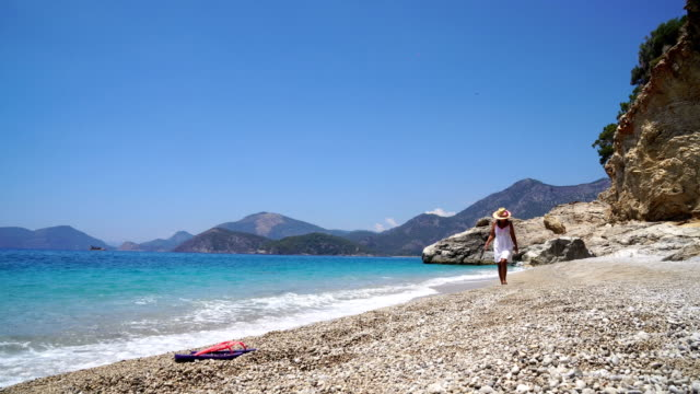 woman walking on the beach - oludeniz stock videos and b-roll footage