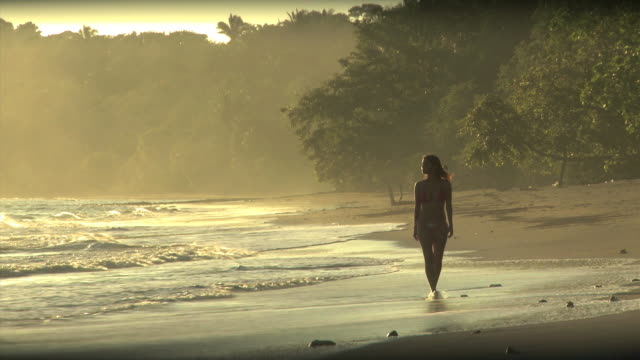 woman walking on the beach - see other clips from this shoot 1157 stock videos & royalty-free footage