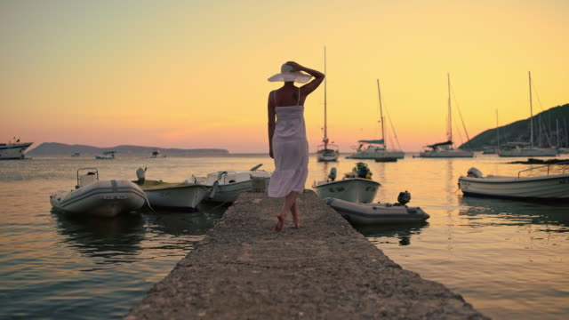 ds woman walking on the pier at sunset - fashionable stock videos & royalty-free footage