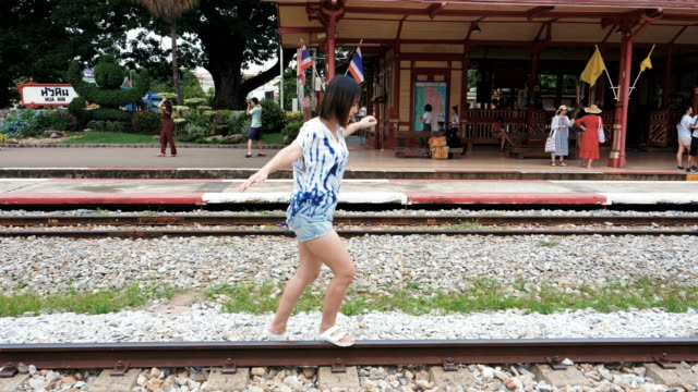 woman walking on the railway, freedom concept - racewalking stock videos and b-roll footage