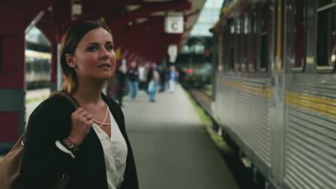 woman walking on train station platform - railroad station stock videos & royalty-free footage