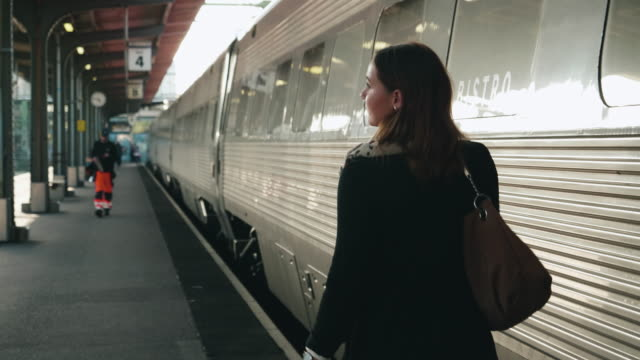 woman walking on train station platform - rail transportation stock videos & royalty-free footage