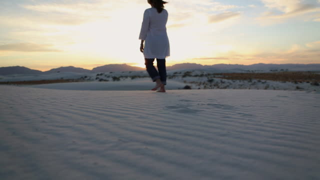 MS Woman walking on white sands / Santa Fe, New Mexico, United States