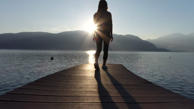 woman walking on wooden jetty by the lake - jetty stock videos & royalty-free footage
