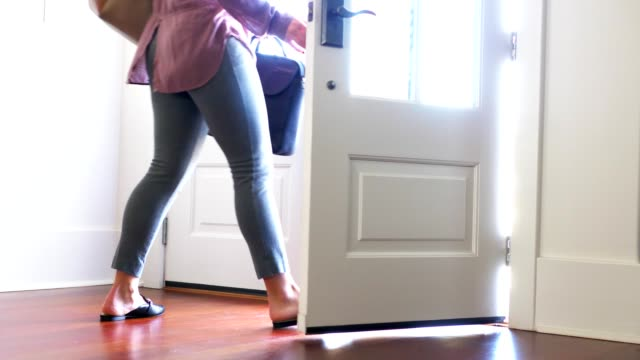 woman walking out from door. - door stock videos & royalty-free footage