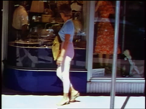 1957 woman walking past stores window shopping / feature - 1957 stock videos & royalty-free footage