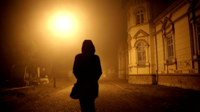 woman walking through a misty night - insanity stock videos & royalty-free footage
