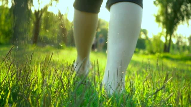 woman walking through green summer grass - barefoot stock videos & royalty-free footage