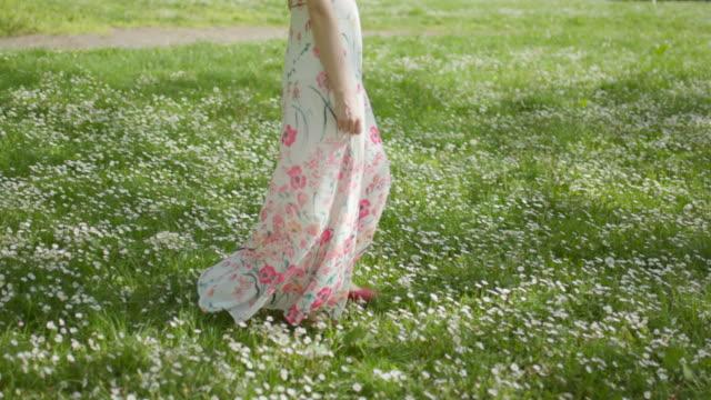 woman walking through park - sundress stock videos & royalty-free footage