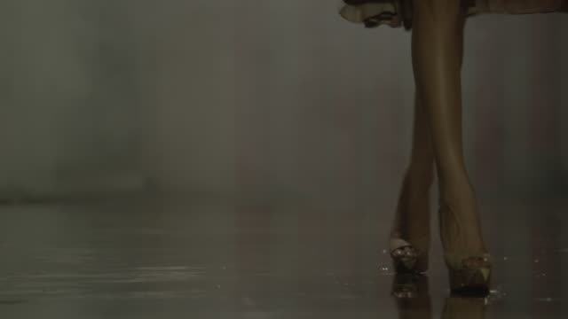 woman walking through steam in basement corridor. - leg stock videos and b-roll footage