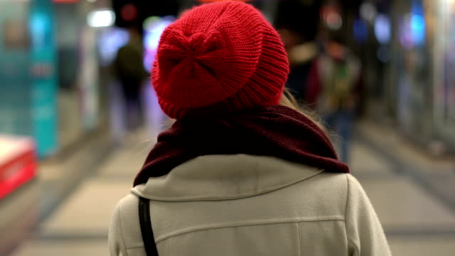 woman walking through the city - rear view stock videos & royalty-free footage