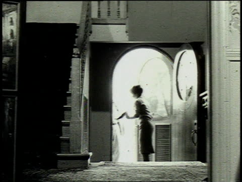 1962 montage woman walking to her front door to get the mail / dallas, texas, united states - post structure stock videos & royalty-free footage