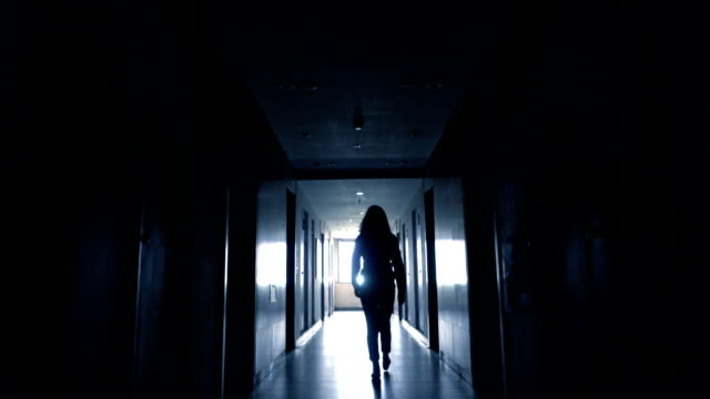 woman walking to light - power cut stock videos & royalty-free footage