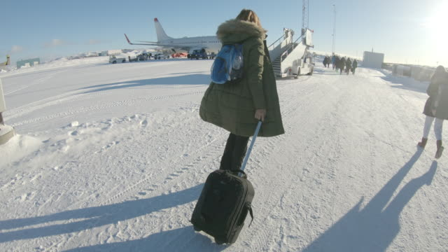 pov woman walking to the aircraft on the airport - carry on luggage stock videos and b-roll footage