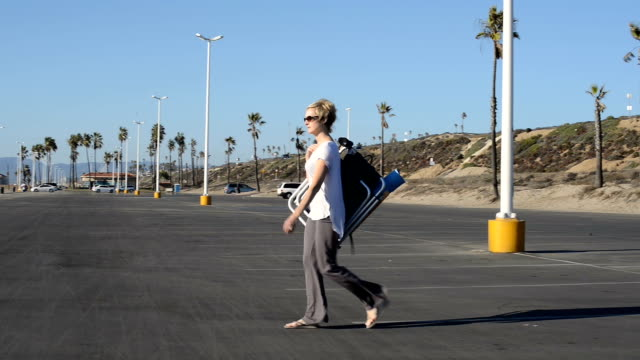 Woman Walking to the Beach
