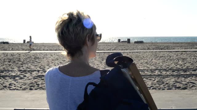 Woman Walking to the Beach