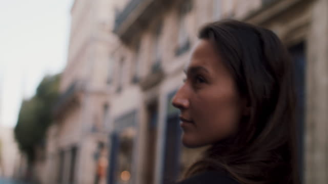 woman walking toward cathedral in bordeaux - businesswoman stock videos & royalty-free footage