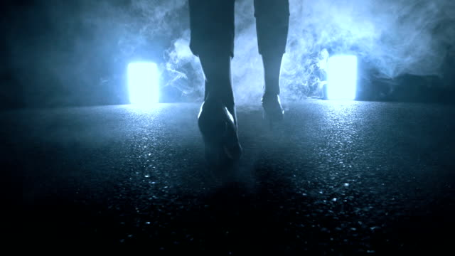 woman walking towards light in dark night. foot steps close up - prison guard stock videos and b-roll footage