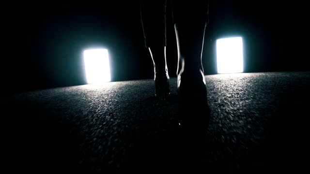 woman walking towards light in dark night. foot steps close up - human foot stock videos and b-roll footage