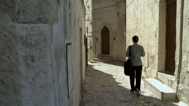 ms woman walking typical alley / matera, basilicata, italy   - only mid adult women stock videos and b-roll footage