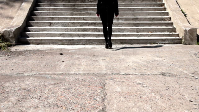 Woman walking up the steps