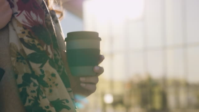 woman walking with a reusable travel mug - mug stock videos & royalty-free footage