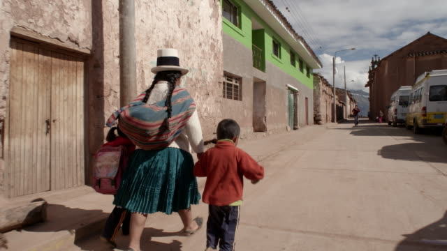 woman walking with children, peru - girls videos stock videos & royalty-free footage
