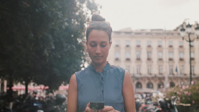 woman walking with phone in bordeaux in the summer - reportage stock videos & royalty-free footage