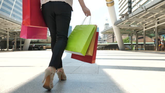 woman walking with shopping bag, low angle - full length stock videos & royalty-free footage