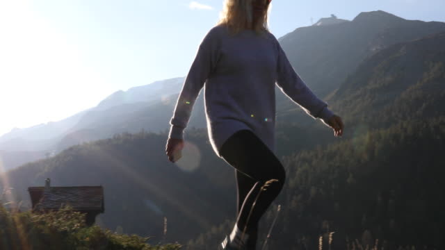 woman walks along high ridge crest, looks off - pullover stock videos & royalty-free footage