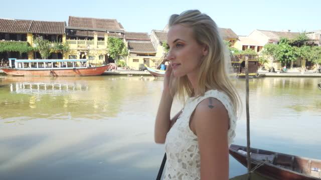 Woman walks along Vietnamese canal
