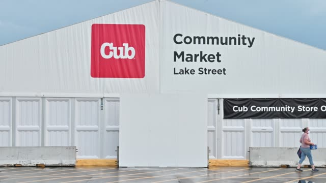 woman walks by outside a temporary cub foods grocery store on july 8, 2020 in minneapolis, minnesota. the temporary store, set up in the parking lot... - temporary stock videos & royalty-free footage