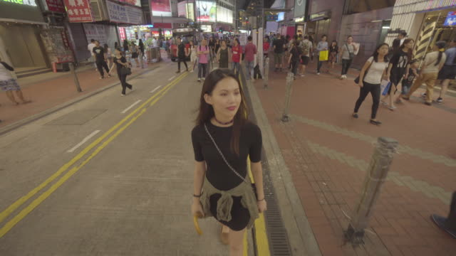 woman walks in hong kong at night, china - poster design stock videos and b-roll footage