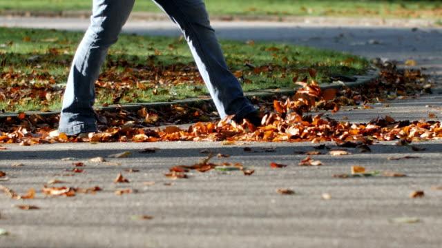 Woman walks in leaves slow motion