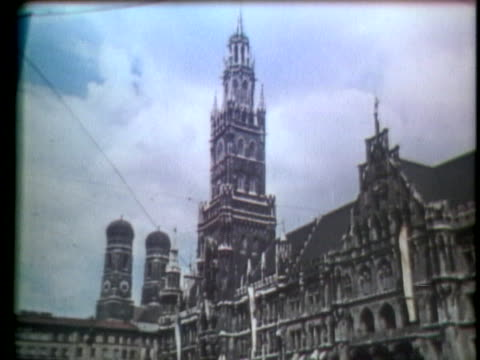 a woman walks on the street near a cathedral in germany - music or celebrities or fashion or film industry or film premiere or youth culture or novelty item or vacations stock-videos und b-roll-filmmaterial