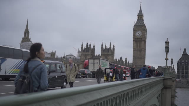 woman walks on westminster bridge, london - uk politics stock videos & royalty-free footage
