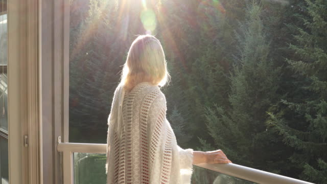 woman walks onto outdoor deck, spreads shawl - shawl stock videos & royalty-free footage